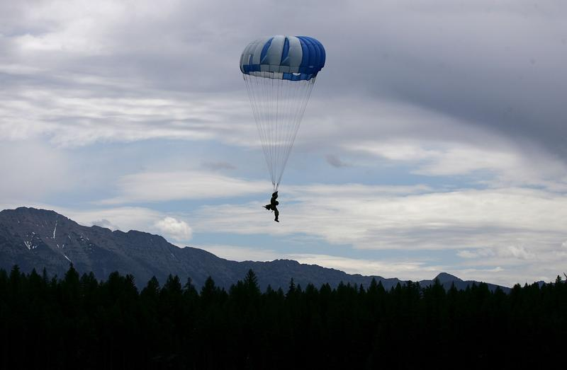 A rookie Smoke Jumper parachutes into Lake Lindbergh as part of Smoke Jumper training June 15, 2007 in Condon, Montana.