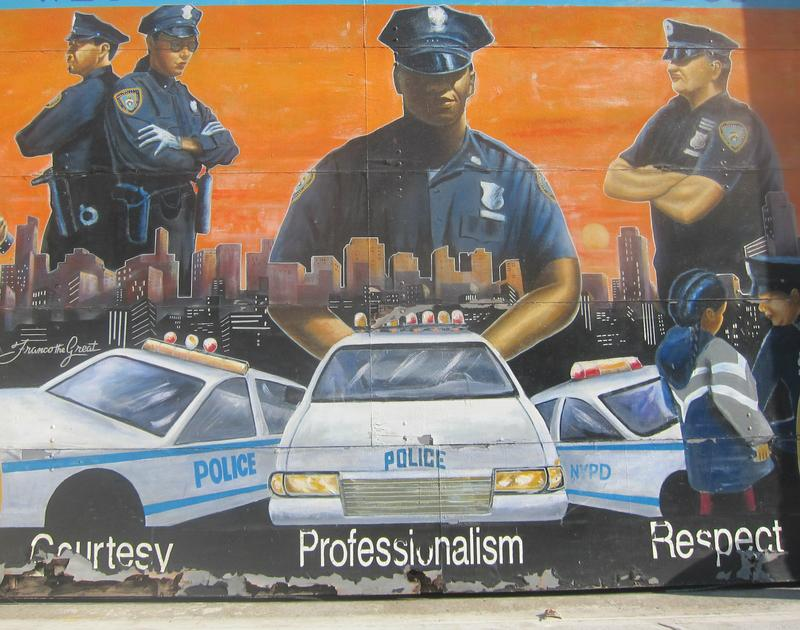 An NYPD mural in Harlem with the courtesy, professionalism and respect slogan.