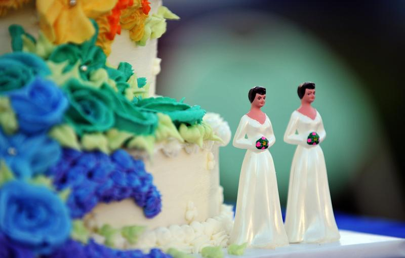 A wedding cake with statuettes of two women is seen in West Hollywood, California, May 15, 2008.