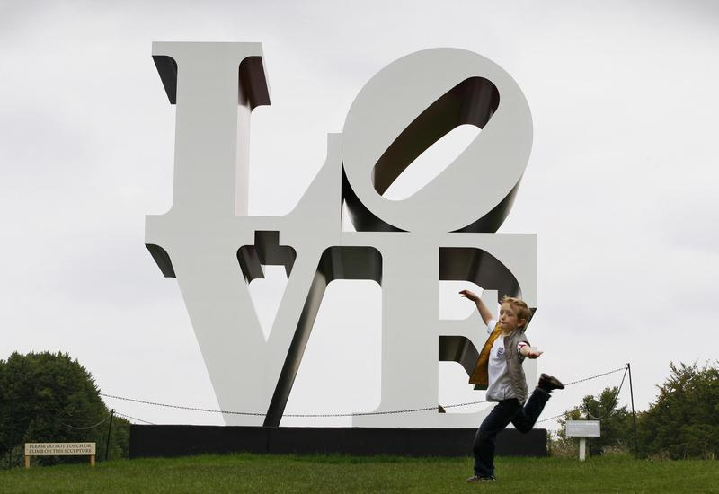 A young boy plays in front of sculpture entitled 'The American Love' by Robert Indiana in the gardens of Chatsworth House near Bakewell, Derbyshire on September 14, 2008.