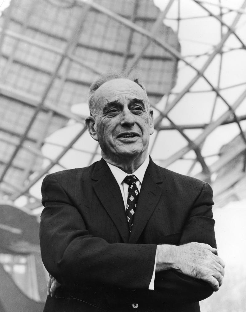 American urban planner Robert Moses (1888 - 1981), president of the World's Fair stands in front of the Unisphere monument at the World's Fair site in Flushing, Queens, New York City, 1964.