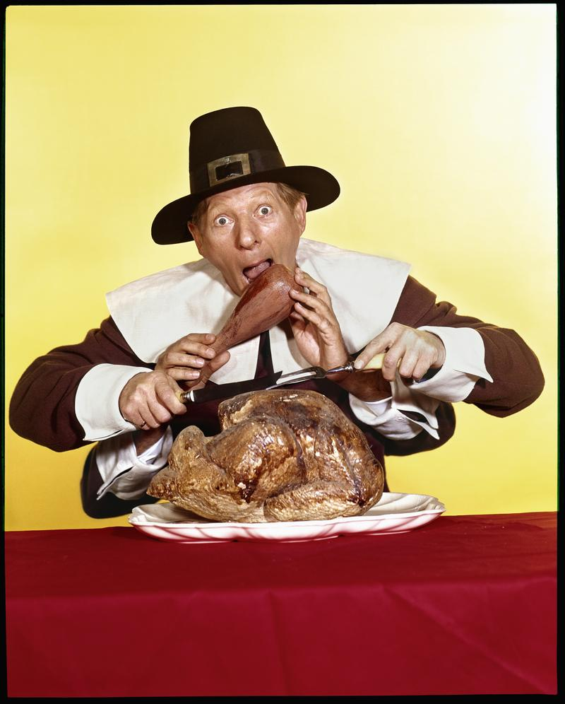The actor and comedian Danny Kaye (1913 - 1987) acts out a Thanksgiving comedy scene while dressed as an American pilgrim circa 1965.