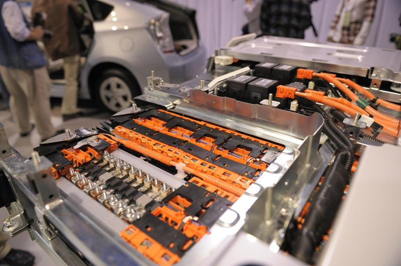 A sample showing the insides of a new lithium-ion battery is on display during Toyota Motors' new Prius Plug-in Hybrid vehicle press preview at the company's showcase, Mega Webb in Tokyo.
