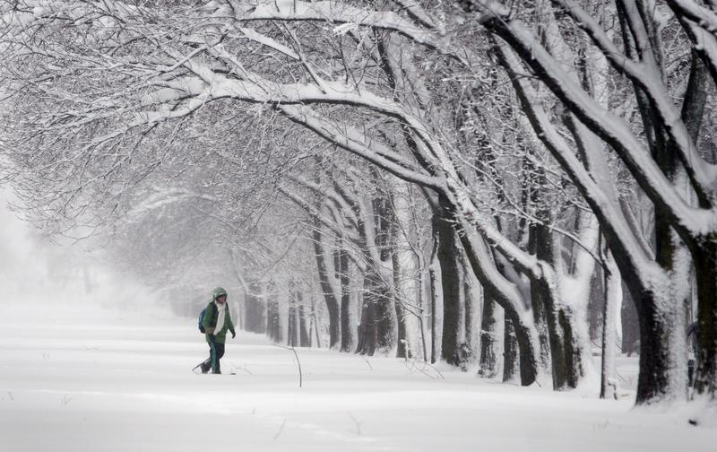 A woman on snowshoes makes her way along The Mall in Washington during a winter snowstorm that buried the city under what could be record-breaking snowfall, February 6, 2010.
