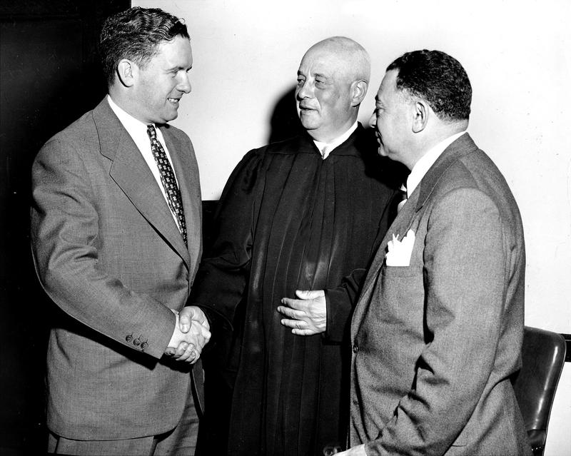 Chief Magistrate John Murtagh is congratulated by Judge Samuel Leibowitz as Brooklyn D.A. Edward Silver looks on, March 8, 1954.