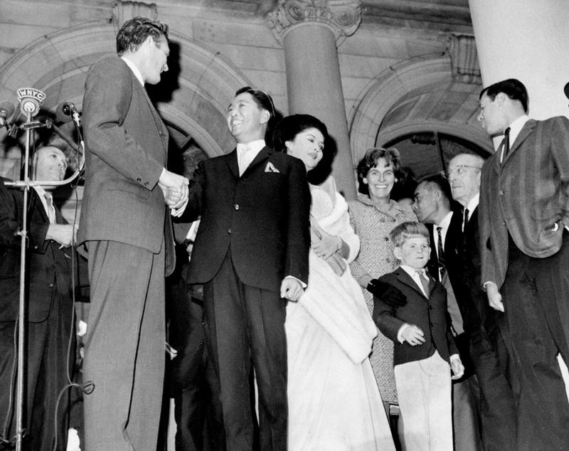 Mayor John Lindsay (left) shakes hands with Philippine President Ferdinand E. Marcos at ceremony, as Mrs. Marcos, Mrs. Lindsay and son John Lindsay Jr. look on, September 21, 1966.