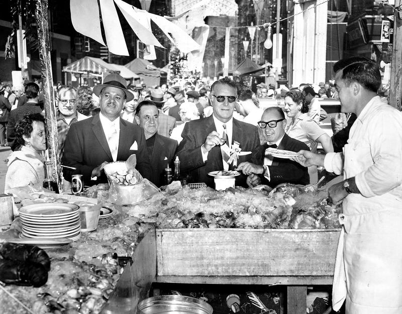 Democratic political leader Carmine DeSapio and Assemblyman Louis DeSalvio at clam bar at the annual feast of San Gennaro in Little Italy, September 20, 1959.