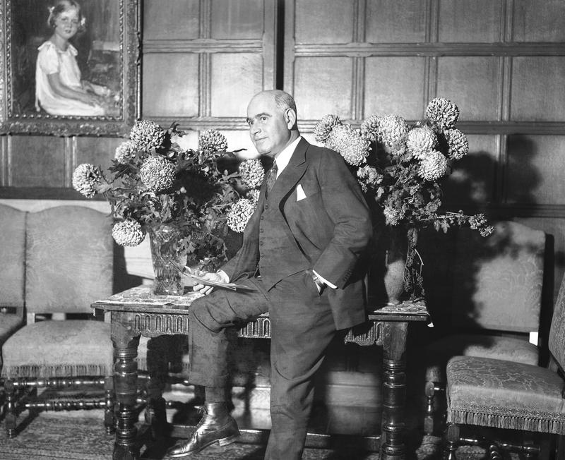 Herbert H. Lehman, who defeated his Republican opponent for governor of New York by 900,000 votes, is shown at his home in New York City, Nov. 9, 1932, holding one of many congratulatory telegrams.