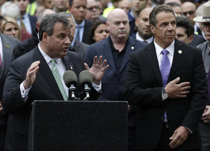 NJ Gov. Chris Christie, left, speaks during a news conference on the train crash at the Hoboken Terminal as NY Gov. Andrew Cuomo, right, listens, Thursday, Sept. 29, 2016, in Hoboken, N.J.