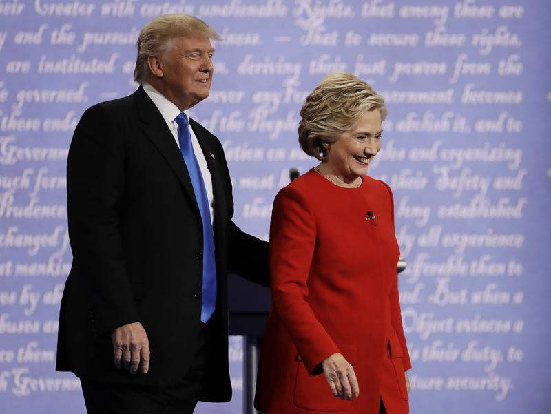 Presidential nominees Donald Trump and Hillary Clinton depart stage following debate at Hofstra University in Hempstead, N.Y., Monday, Sept. 26, 2016
