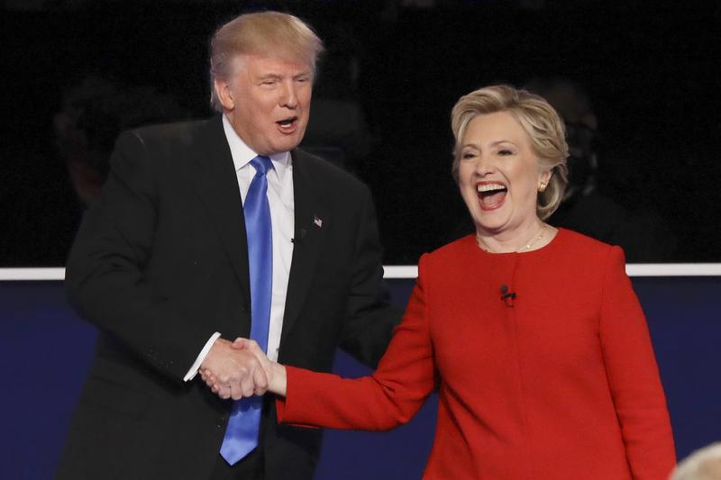 Presidential nominees Donald Trump and Hillary Clinton shake hands following debate at Hofstra University in Hempstead, N.Y., Monday, Sept. 26, 2016