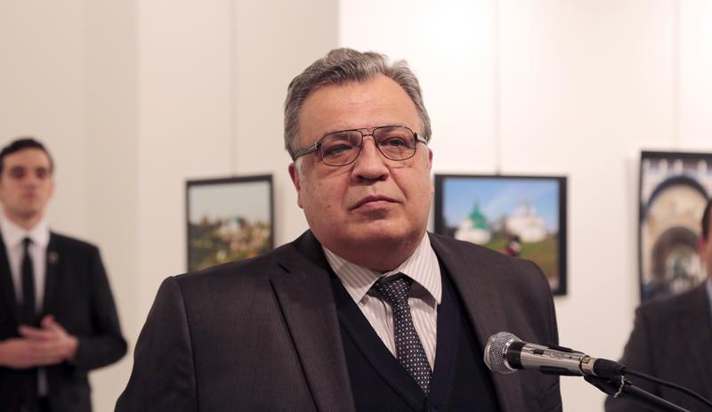 The Russian Ambassador to Turkey Andrei Karlov speaks a gallery in Ankara Monday Dec. 19, 2016.