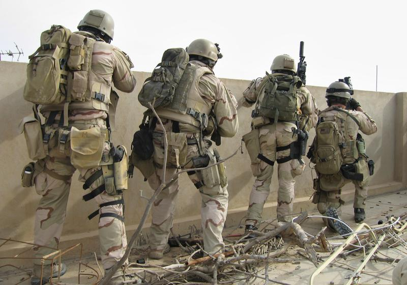 A team of U.S. Navy SEALs fires on insurgents from a rooftop Friday, April 21, 2006 in Ramadi 115 km (70 miles) west of Baghdad, Iraq.