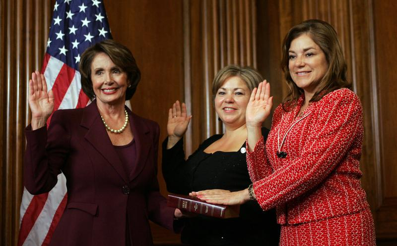 sisters, Reps. Linda Sanchez, D-Calif., left, and Loretta Sanchez, D-Calif, pose during a re-enactment of their swearing-in ceremony on Capitol Hill in Washington, Jan. 4, 2007.