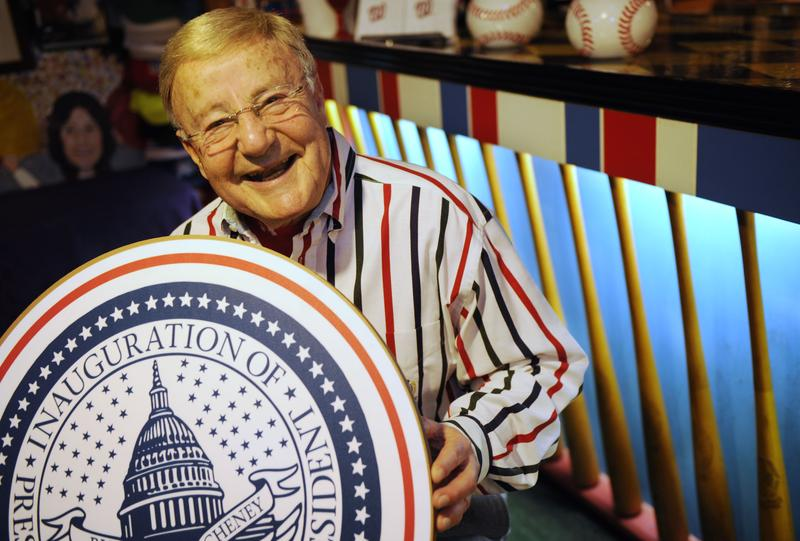 Charlie Brotman, 81, holds a large inaugural seal from 2005's inauguration, in his basement in Takoma Park, Md., Thursday, Jan. 8, 2009.