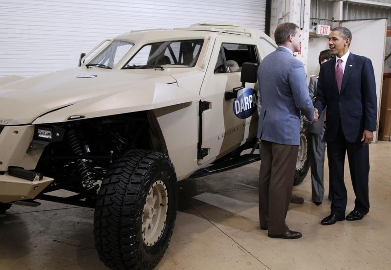 Former President Barack Obama is shown the DARPA Car as he tours Carnegie Mellon University in June 2011.