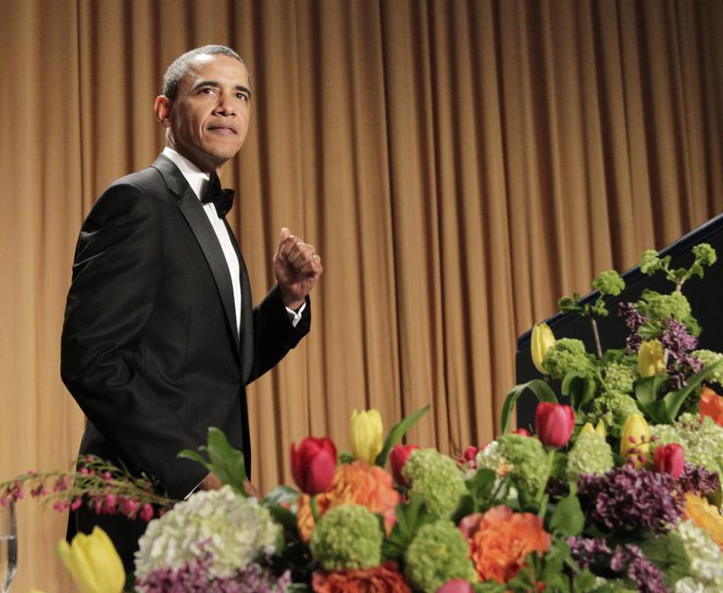 President Barack Obama pumps his fist as he walks to the rostrum during the White House Correspondents' Association Dinner in Washington, Saturday, April 30, 2011.