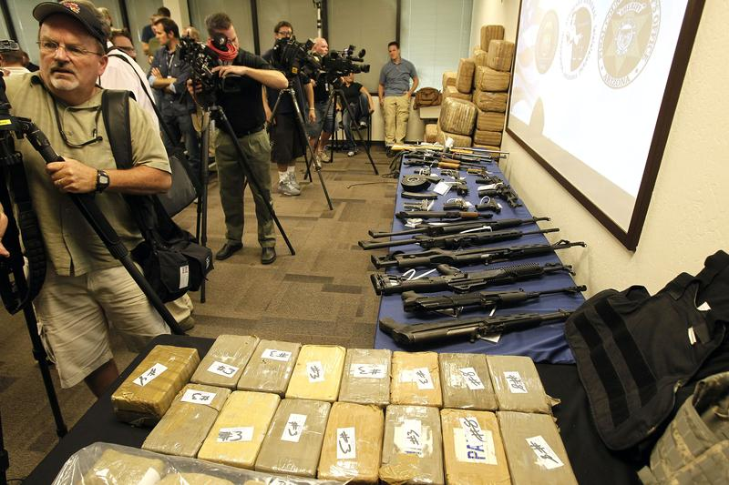Television cameramen shoot footage of seized evidence after a news conference as a variety of law enforcement agencies announce a bust on a major drug smuggling ring in Arizona, Monday, Oct. 31, 2011.