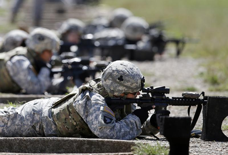 Female soldiers train on a firing range while testing new body armor in Fort Campbell, Ky.