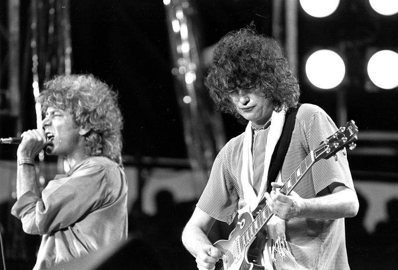 In this July 13, 1985 file photo, singer Robert Plant, left, and guitarist Jimmy Page of the British rock band Led Zeppelin perform at the Live Aid concert at Philadelphia's J.F.K. Stadium.