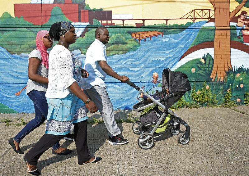 A family walks to a neighborhood park in the Bronx.