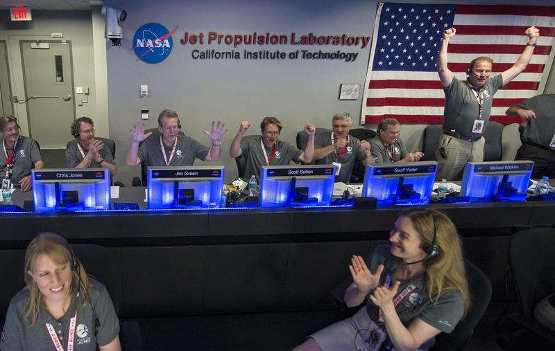 In this photo provided by NASA, Juno team members celebrate in mission control of the Space Flight Operations Facility at the Jet Propulsion Laboratory after receiving confirmation from the spacecraft