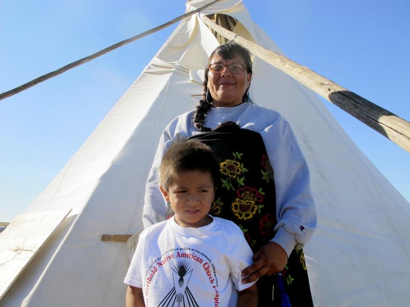 Melaine Stoneman, a Lakota Sioux from the Pine Ridge Reservation, poses with her 5-year-old son in a Dakota Access protest encampment.
