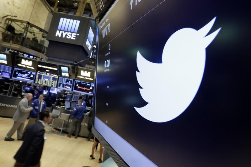 In this July 27, 2016, file photo, the Twitter symbol appears above a trading post on the floor of the New York Stock Exchange.
