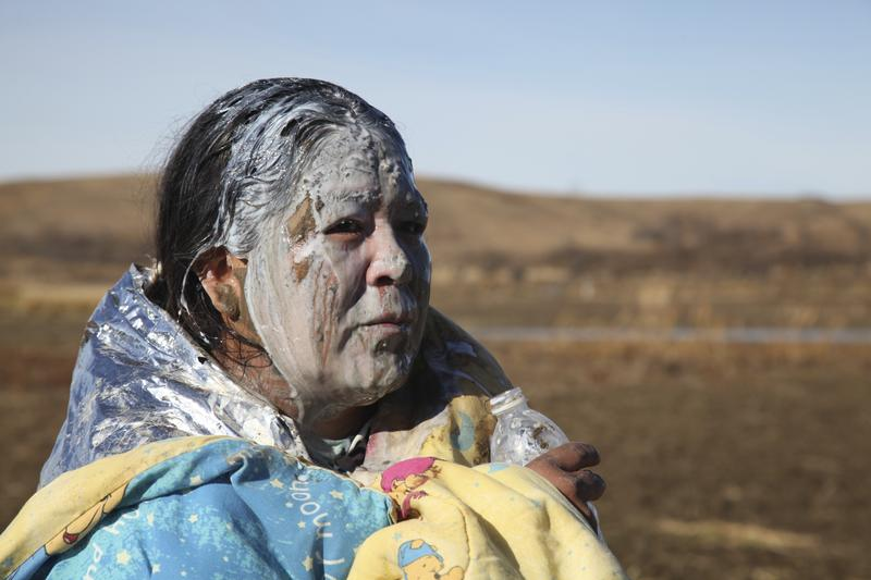 Tonya Stands recovers after being pepper sprayed by police after swimming across a creek with other protesters hoping to build a new camp to block construction of the Dakota Access Pipeline, near Cann
