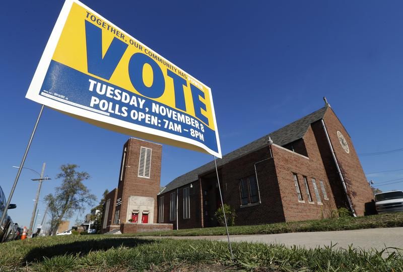 A get out the vote sign is shown outside St. Matthew Missionary Baptist Church in Detroit, Sunday, Nov. 6, 2016.