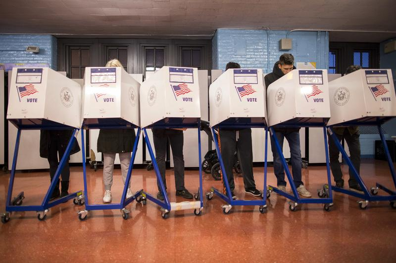 Voters fill out their forms at a polling station in the Brooklyn borough of New York, Tuesday, Nov. 8, 2016.