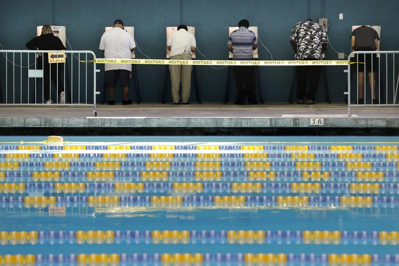 People cast their votes at Echo Park Pool on Tuesday, Nov. 8, 2016, in Los Angeles.