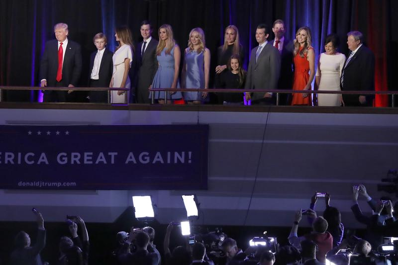 President-elect Donald Trump, left, followed by his family are photographed by members of the media as they arrive at his election night rally, Wednesday, Nov. 9, 2016, in New York.