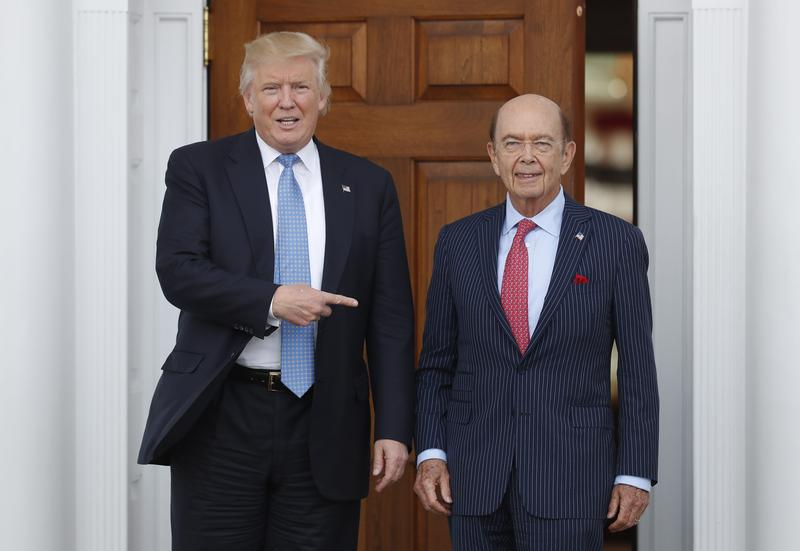 President-elect Donald Trump, left, stands with investor Wilbur Ross after meeting at the Trump National Golf Club Bedminster clubhouse in Bedminster, N.J.