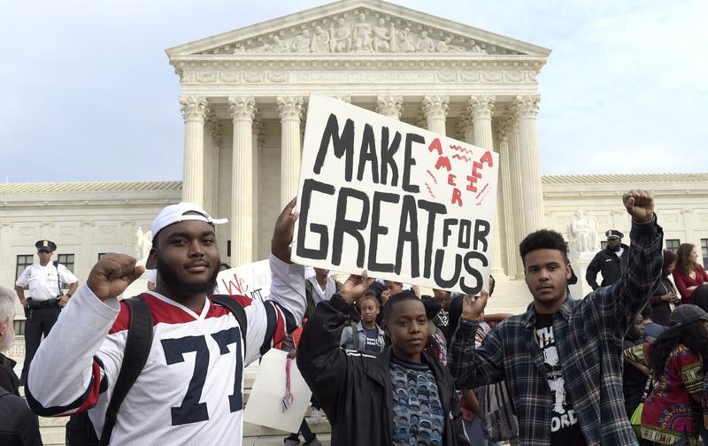 High school students protest Donald Trump's election outside the Supreme Court building in Washington.