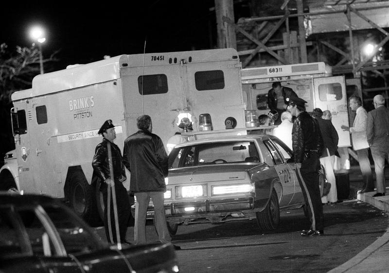 In this Oct. 21, 1981, file photo, police are at the scene of a Brinks armored truck robbery at the Nanuet Mall in Nanuet, N.Y., where two Nyack police officers and a Brinks guard were killed