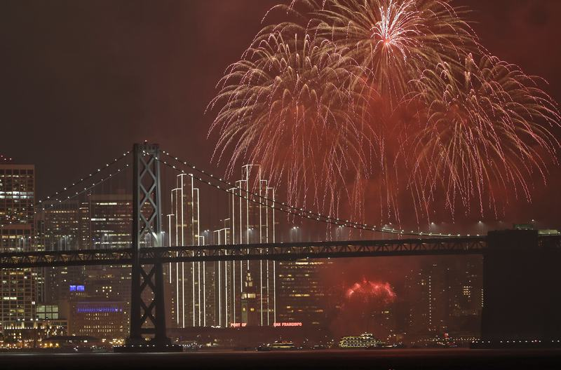 Fireworks explode over the San Francisco Oakland Bay Bridge as part of New Year's Eve celebrations Sunday, Jan. 1, 2017, in San Francisco.