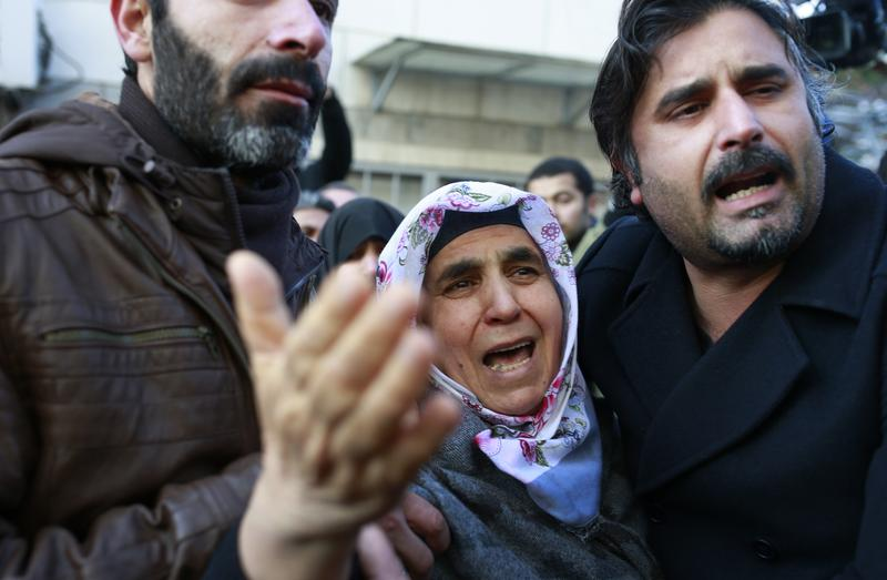 Relatives cry during the funeral of Fatih Cakmak, one of the victims of the attack at a nightclub on New Year's Day, in Istanbul, Monday, Jan. 2, 2017.