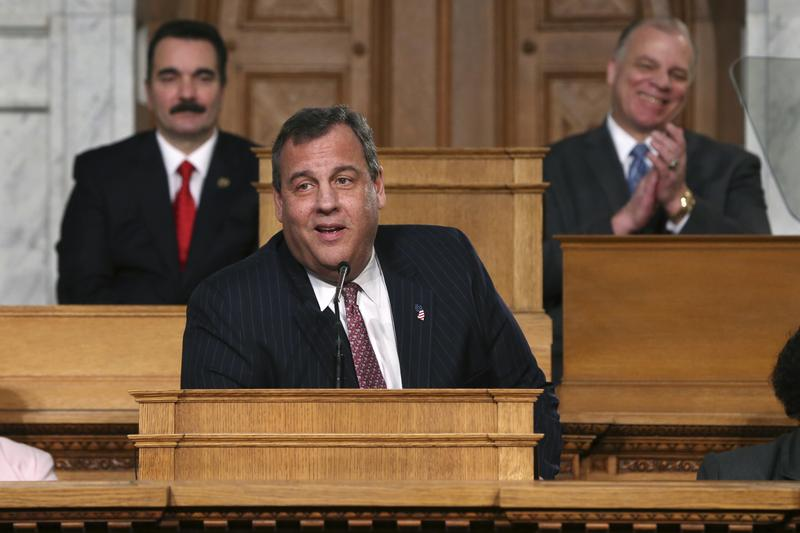 New Jersey state Assembly Speaker Vincent Prieto, left, and state Senate President Steve Sweeney, right, smile as Gov. Chris Christie delivers his State of the State address.