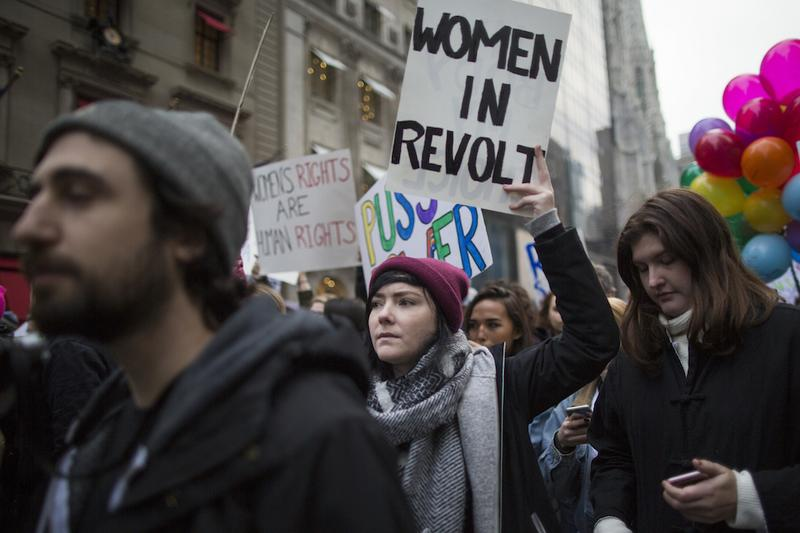 Demonstrators march up 5th Avenue during a women's march, Saturday, Jan. 21, 2017, in New York.