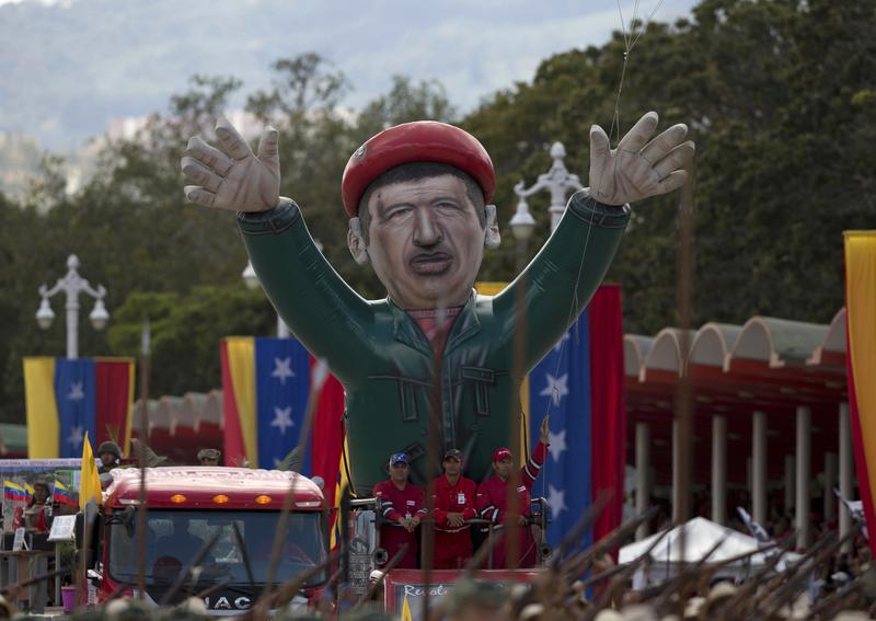 Soldiers parade a large inflatable figure of the late President Hugo Chavez in Caracas, Venezuela.