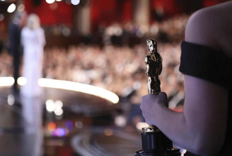 One of the best picture Oscar statuettes appears off stage as Warren Beatty and Faye Dunaway announce the best picture winner at the Oscars on Sunday, Feb. 26, 2017, at the Dolby Theatre in L.A.
