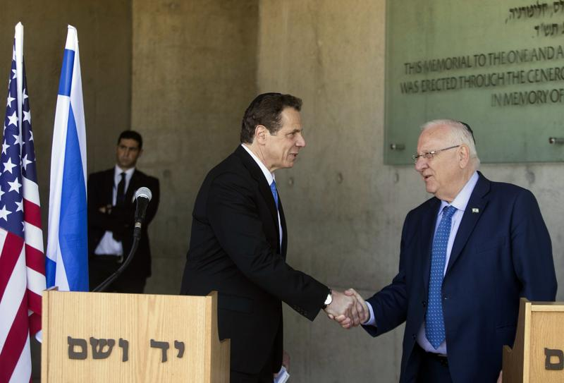 The Governor of New York Andrew M. Cuomo and Israeli President Reuven Rivlin shake hands at the Yad Vashem Holocaust memorial, in Jerusalem, Sunday, March 5, 2017.