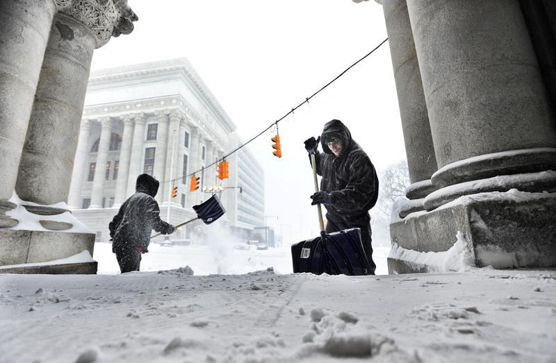 Cleaning crews removing snow from an entrance to the state Capitol in Albany. March 14, 2017.
