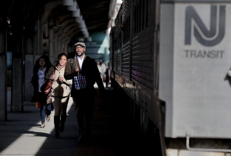 New Jersey Transit commuters rush to catch a train heading for Gladstone, N.J., Wednesday, April 5, 2017, in Hoboken, N.J.