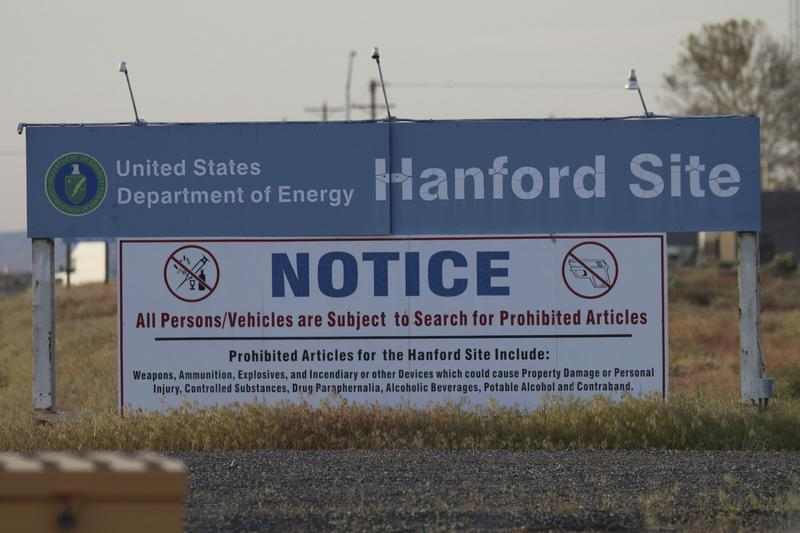 Signs are posted by the Hanford Nuclear Reservation in Benton County, Tuesday, May 9, 2017, in Richland, Washington.