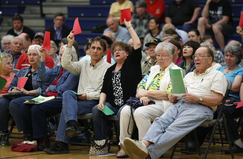 Audience members react as Rod Blum, R-Iowa, speaks during a town hall meeting on Thursday, May 11, 2017, in Marshalltown, Iowa.