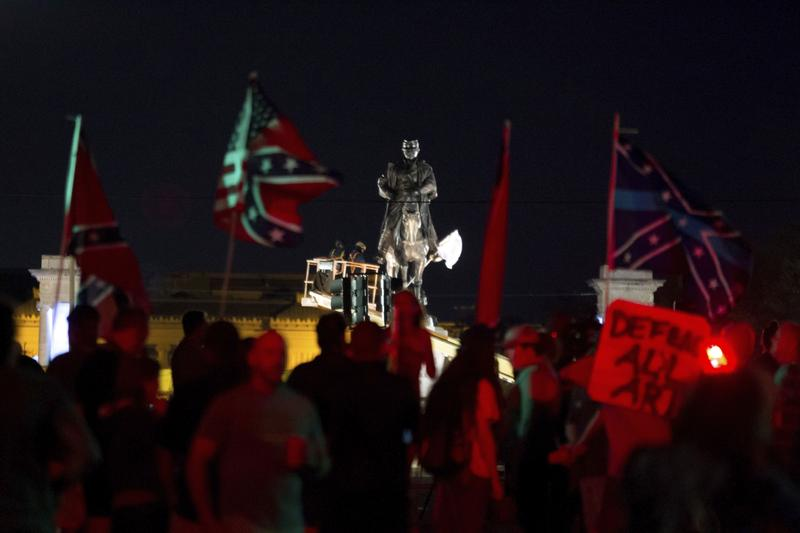 A statue of Confederate Gen. P.G.T. Beauregard is prepared for removal from the entrance to City Park in New Orleans, Tuesday, May 16, 2017.