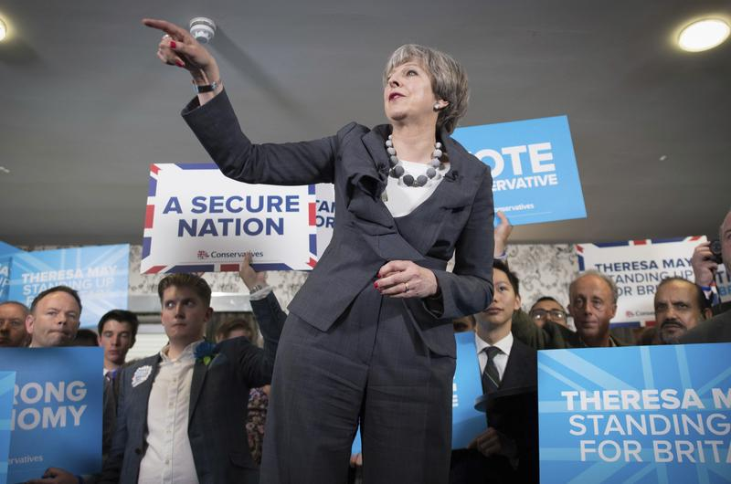 Britain's Prime Minister Theresa May makes a speech during her visit to Longton rugby club in Stoke central England while on the General Election campaign trail, Tuesday June 6, 2017.
