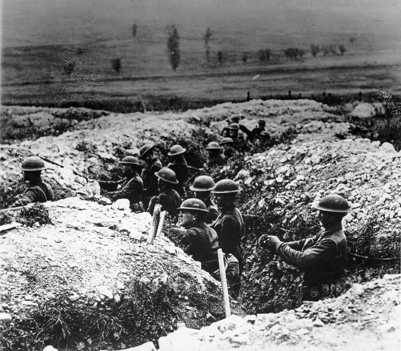 U.S. troops stand in trenches during World War I in France in 1918.